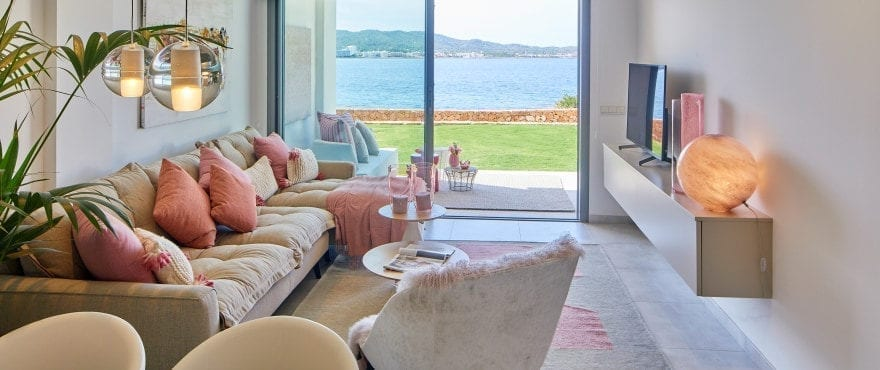 Bright living-dining room at Sunset Ibiza, with a large terrace and sea views