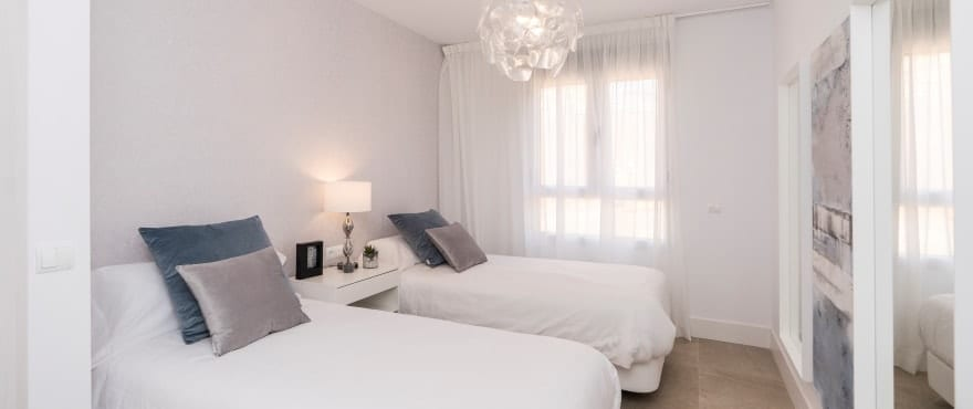 Bright bedroom with views of the golf course at Natura