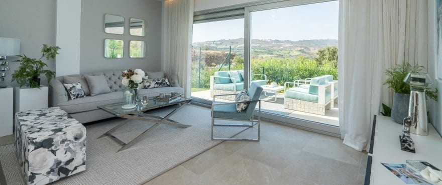 Spacious, bright living room with panoramic views over the golf course