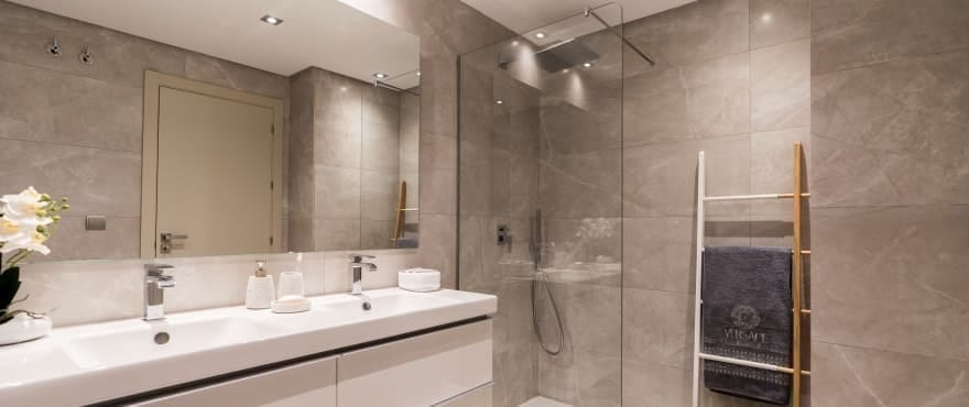 Modern fully equipped bathroom at Harmony, with shower screen installed